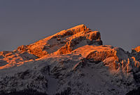 First sun light at the snow-covered Piz da Lec de Boe, Sella group, Dolomites, South Tyrol, Italy