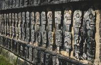 Wall with carved skulls in a Mayan temple in Chichen Itza, Yucatan, Mexico