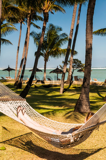 Relaxing on a hammock on a beach in Mauritius