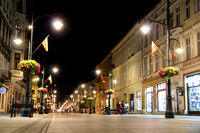 View of the evening city from below. Main touristic street of Polish city Lodz Piotrkowska in night