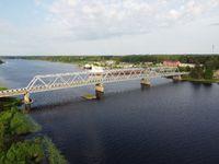 truss iron bridge through river,view an air,aerial photo