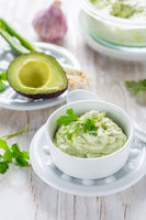 Delicious avocado spread with curd cheese and ingredients. Heathy food concept.