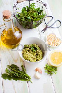 Wild herbs pesto on the white table