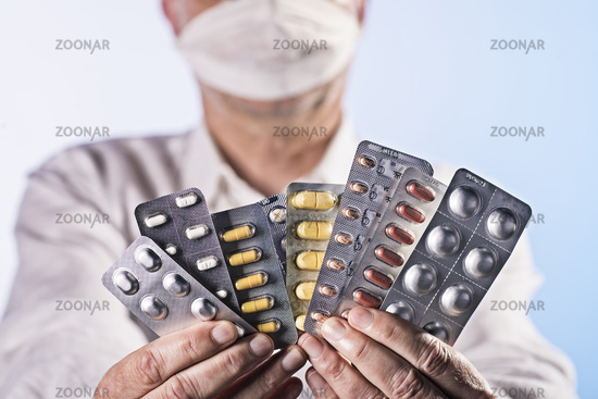 Doctor holding blisters with drugs in the hands