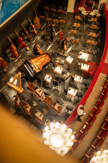 Orchestra pit without artists in the interior of the Vienna State Opera auditorium.