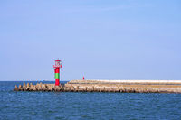Lighthouse on the east pier on the coast of Warnemuende in Germany