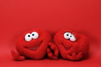 Two toy red cartoon hearts