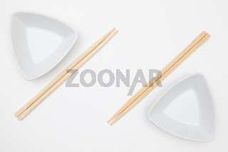 Top View Of White Empty Sushi Plates With Bamboo Chopsticks.