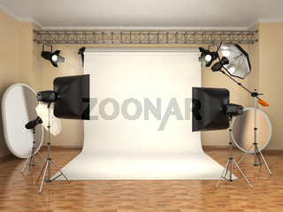 Photo studio with lighting equipment. Flashes, softboxes and reflectors.