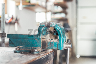 Vice workshop concept: Close up of a blue, metal vice