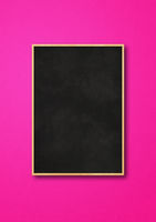 Traditional black board isolated on a pink background