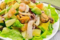 Salad seafood and lettuce on light board