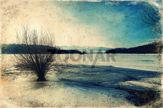 Beautiful landscape, lake and houseboat with mountain in background old photo effect.