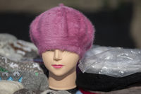 Shopping manikin in a knitted hat. Selling knitted hats.