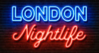 Neon sign on a brick wall - London Nightlife