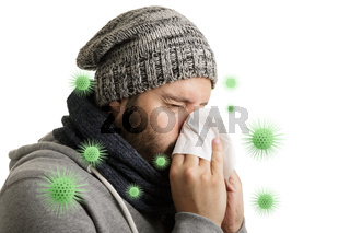 A man in winter time with virus disease has to sneeze and blows into a handkerchief isolated on white background.
