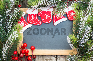 Blackboard blank framed in beautiful Christmas tree branches and decorations