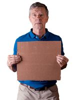 Senior man holding a blank cardboard sign with a sad expression isolated against white