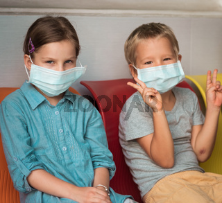 Kids wearing facial disposable mask. Virus protection