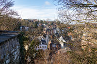 View through tree branches at the city stolberg, Eifel
