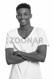 Young happy African man in black and white