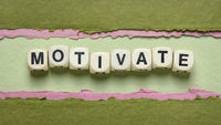 motivate word abstract in wooden letter cubes