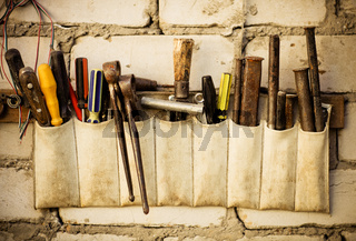 Tools renovation on grunge old brick wall