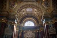 Painting murals and frescoes inside Catholic Cathedral interior in Budapest.