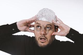 paranoid man wearing tin foil hat