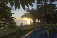 Bali. Amed. Sunrise over the black sand beach.