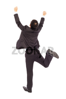 excited businessman raising hands to celebrate