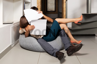 Young couple flirting in office