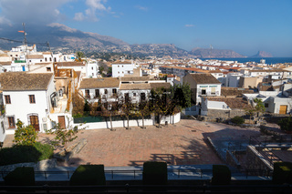 Outlook at the old town square Placa l'Aigua with view over skyline and ocean with mountains, Altea, Costa Blanca, Spain