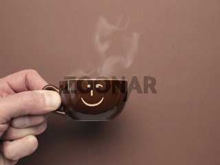 Brown espresso cup with a smiling icon