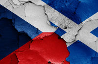 flags of Czech Republic and Scotland painted on cracked wall