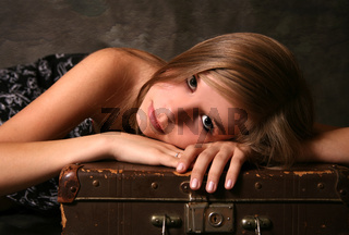 Girl with old suitcase