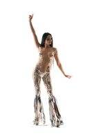 Slim seductive woman in foil costume in studio