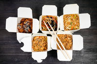 top view of chinese fast food in disposable boxes