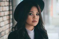 Closeup portrait of beautiful young asian female outdoors