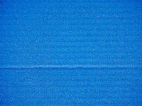 Blue corrugated cardboard background