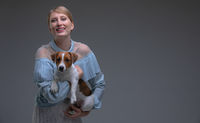 Woman in vintage dress hold jack russell dog