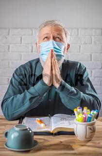 Wearing mask in prayer against viruses disease