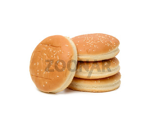stack of baked round burger buns isolated on white background