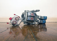 vintage bot lost his head on a old wooden floor