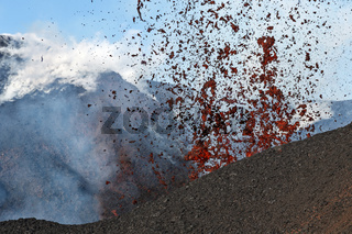 Fountain of red hot lava erupting from crater of active volcano