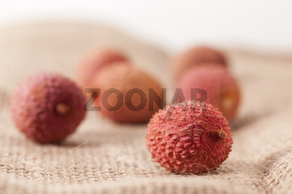 Lychee fruits on sackcloth