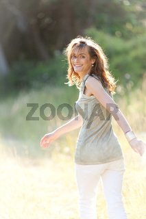 attractive smiling adult woman outside in summer
