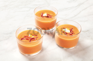 Salmorejo, Spanish cold tomato soup, in glasses on a marble background
