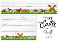Easter Eggs on Grass and Wooden Background