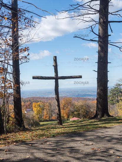 Wooden cross overlooking fall trees near Uniontown, Pennsylvania
